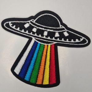 Strygemærke af UFO med regnbue